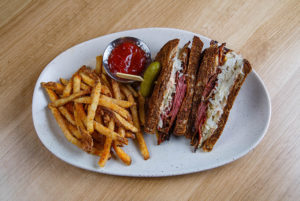 Pastrami Reuben sandwich and fries.